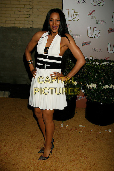 CIARA.US Weekly Presents Us' Hot Hollywood 2007 held at Sugar,  Hollywood, California, USA..April 26th, 2007.full length dress hands on hips black white halterneck straps belt .CAP/ADM/RE.©Russ Elliot/AdMedia/Capital Pictures
