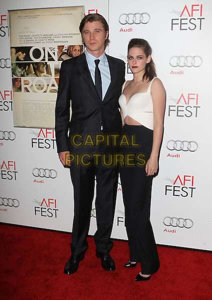 Garrett Hedlund, Kristen Stewart.AFI FEST 2012 'On The Road' gala screening, Grauman's Chinese Theatre, Hollywood, California, USA..3rd November 2012.full length white top cut out away black trousers suit blue shirt.CAP/ADM/KB.©Kevan Brooks/AdMedia/Capital Pictures.