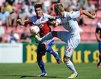 FUSSBALL  DFB POKAL        SAISON 2012/2013 SpVgg Unterchaching - 1. FC Koeln  18.08.2012 Maximilian Welzmueller (li, Unterhaching) gegen Kasper Przybylko (1. FC Koeln)