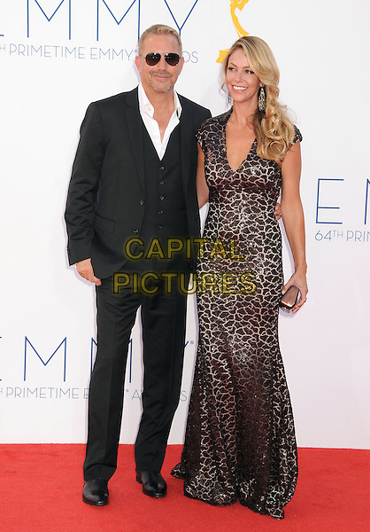 Kevin Costner, Christine Baumgartner.The 64th Anual Primetime Emmy Awards held at Nokia Theatre L.A. Live in Los Angeles, California, USA..September 23rd, 2012.emmys full length dress black suit waistcoat white shirt brown sunglasses shades married husband wife.CAP/ADM/BP.©Byron Purvis/AdMedia/Capital Pictures.