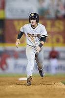 Billy Fleming (8) of the Charleston RiverDogs takes off for third base against the Hickory Crawdads at L.P. Frans Stadium on August 25, 2015 in Hickory, North Carolina.  The Crawdads defeated the RiverDogs 7-4.  (Brian Westerholt/Four Seam Images)