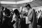An Irish priest holds the communion with Turkana tribespeople,  Nr Kakuma, Northern Kenya.