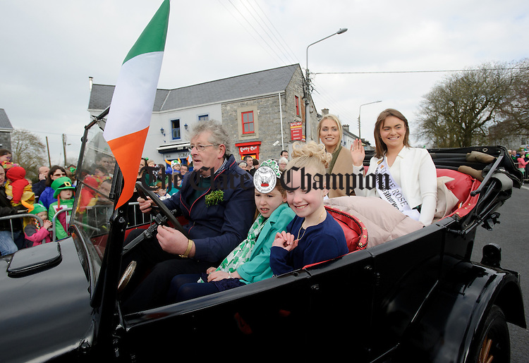 Pat Foudy with his car load of ladies during the St Patrick's Day parade in Ennis. Photograph by John Kelly.