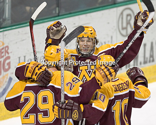 Ryan Potulny (hidden), Ryan Stoa, Danny Irmen and Alex Goligoski celebrate Potulny's first goal of the game - The University of Minnesota Golden Gophers defeated the University of North Dakota Fighting Sioux 4-3 on Saturday, December 10, 2005 completing a weekend sweep of the Fighting Sioux at the Ralph Engelstad Arena in Grand Forks, North Dakota.