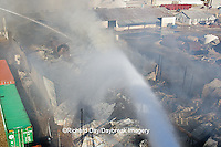 63818-02318 Firefighters extinguishing warehouse fire using aerial ladder truck viewed from top of ladder, Salem, IL