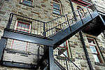 Fire escape on side of stone building
