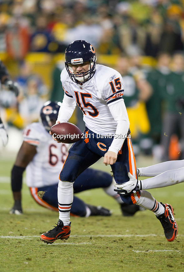 Chicago Bears quarterback Josh McCown (15) scrambles for yardage during a week 16 NFL football game against the Green Bay Packers on December 25, 2011 in Green Bay, Wisconsin. The Packers won 35-21. (AP Photo/David Stluka)