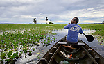 Narivaldo Dos Santos paddles a boat on the Ituqui River near his home in the Quilombo Bom Jardim, outside Santarem, Brazil. The Ituqui flows into the nearby Amazon River.