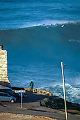 6th January 2018, Praia do Norte, Nazaré , Portugal;  A spectator observes different pro surfers at the Faro in Praia de Norte, Nazaré