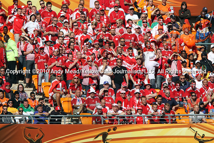 14 JUN 2010:  Denmark supporters in the stands.  The Netherlands National Team played the Denmark National Team at Soccer City Stadium in Johannesburg, South Africa in a 2010 FIFA World Cup Group E match.