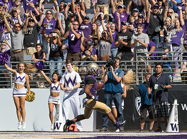 Freshman Myles Gaskin scores the first of his three touchdowns.