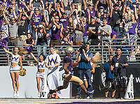 Freshman Myles Gaskin scores the first of his three touchdowns.