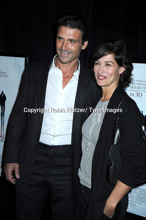 "actor Frank Grillo and Wendy Moniz posing for photographers at a special screening of ""My Soul to Take"" on October 6, 2010 at The AMC Loews Lincoln Square in New York City."