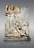 Roman Sebasteion relief  sculpture of the goddess Roma and Ge (Earth),  Aphrodisias Museum, Aphrodisias, Turkey. <br /> <br /> The goddess Roma holds a spear and wears a crown in the form of a city wall. Earth reclines half naked leaning on a pile of fruit. She holds a cornucopia full of more fruit. A baby child (now damaged) climbs up the horn she holds. The relief represents Earths fertility and abundance overseen by Rome.