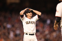 SAN FRANCISCO, CA - AUGUST 13:  Ryan Theriot #5 of the San Francisco Giants reacts in the third inning as the Washington Nationals scored 7 runs during the game at AT&T Park on Monday, August 13, 2012 in San Francisco, California. Photo by Brad Mangin