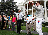 Washington, DC - September 16, 2009 -- United States President Barack Obama fences playfully with Olympic Champion Tim Morehouse,  during an event on Olympics, Paralympics and Youth Sport Canadian on the South Lawn of the White House, Washington, DC, September 16, 2009. .President Obama and his wife Michelle are supporters of  the candidacy of the city of Chicago as the city host for the Summer Olympic Games 2016..Credit: Aude Guerrucci / Pool via CNP
