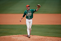 Greensboro Grasshoppers relief pitcher Travis Neubeck (30) gets the ball back from the catcher during a game against the Lakewood BlueClaws on June 10, 2018 at First National Bank Field in Greensboro, North Carolina.  Lakewood defeated Greensboro 2-0.  (Mike Janes/Four Seam Images)