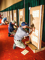 Wade Hooker (cq, right) with Patrick County hangs targets during a practice shoot at the 2014 Daisy National BB Gun Championship Match in Rogers, Arkansas, Friday, July 4, 2014.<br /> <br /> Photo by Matt Nager