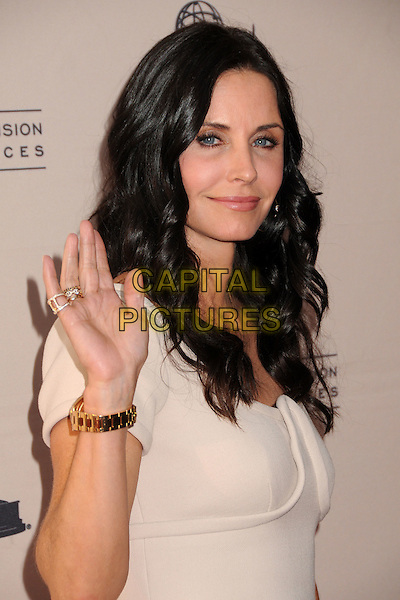 "COURTENEY COX.An Evening With ""Cougar Town"" held at the Academy Of Television Arts & Sciences, North Hollywood, California, USA, 20th April 2011..portrait headshot cream nude  wavy hair beauty hand waving .CAP/ADM/BP.©Byron Purvis/AdMedia/Capital Pictures."