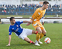 RYAN FINNIE TRIES TO GET AWAY FROM COWDENBEATH'S LIAM CUSACK.