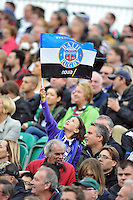 A Bath fan in the crowd waves a flag in support. Aviva Premiership match, between Bath Rugby and Leicester Tigers on September 14, 2013 at the Recreation Ground in Bath, England. Photo by: Patrick Khachfe / Onside Images