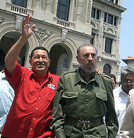 "President of Venezuela Hugo Chavez, (left), the Cuban President Fidel Castro, and Historia Eusebio Leal, greet when arriving at the ""Simon Bolivar´s House"" to inaugurate the offices of PDVESA, April 28, 2005. Castro joined Chavez AT the opening of the South oil American nation's new company office in Cuba ace the leftist leaders to further integrated to their economies and promoted to hemispheric trade pact that would exclude the United States.arrive at the building of the ""Lonja del Comercio"", Havana, Cuba, April 28, 2005. Chavez and Fidel inaugurate a PDVSA office (Petroleos Venezuelan).  Credit: Jorge Rey/MediaPunch"