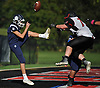 Tate Atherton #9 of Northport, left, has a punt from the end zone blocked by Paul Achenbach #72 of Patchogue-Medford during the second quarter of a Suffolk County Division I varsity football game at Half Hollow Hills East High School in Dix Hills on Sunday, Oct. 1, 2017. The blocked punt resulted in a safety for Patchogue-Medford.
