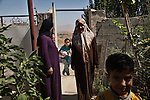 09/08/14. Goktapa, Iraq. Rahima visiting her neighbors.