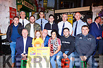 Denis and Marie Carroll launching the Darkness into Light Nathans Walk in aid of Pieta House in Reidys Bar Killarney on Monday night Front row: Con O'Connor pieta House, Layla Murphy, Denis, Marie and Ryan O'Carroll, Chris Manton. Back l-r: Damian O'Carroll, Superintendent Flor Murphy, Killian O'Carroll, Garda James McCarthy, Aaron Superintendent Dan Keane Sargent Dermot O'Connell.