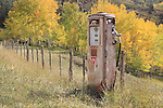 Antique Conoco gas pump with autumn aspen trees, Telluride, Colorado.