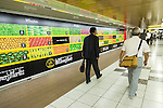 Commuters walk past a massive 80 meter ''Wall Farmer's Market'' information poster in the Tokyo Metro passageway in Shinjuku on September 1, 2015, Tokyo, Japan. The Central Union of Agricultural Co-operatives (JA-ZENCHU) is promoting Japanese vegetables with the vegetable columns and a massive 80 meter information poster until September 6th. (Photo by Rodrigo Reyes Marin/AFLO)