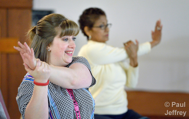 Donnelle Storrs, a faith community nurse at Chapel Hill United Methodist Church in San Antonio, Texas, stretches as she leads an exercise group at the church.