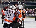 OMAHA, NE - FEBRUARY 9:  The Omaha Lancers celebrate a goal against the Lincoln Stars in the first period at the Battle on Ice Saturday at TD Ameritrade in Omaha, NE. (Photo by Dave Eggen/Inertia)