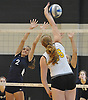 South Side No. 2 Kiersten Colvin, left, defends against a spike attempt by Wantagh No. 16 Nicole Hilton during a Nassau County varsity girls' volleyball match at Wantagh High School on Friday, October 23, 2015. Wantagh won 25-15, 25-17, 28-26.<br /> <br /> James Escher
