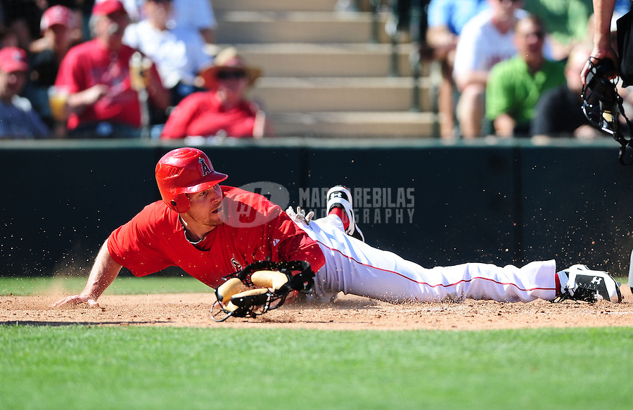 Mar. 6, 2012; Tempe, AZ, USA; Los Angeles Angels base runner Ryan Langerhans after being tagged out at home in the third inning against the Chicago White Sox during a spring training game at Tempe Diablo Stadium.  Mandatory Credit: Mark J. Rebilas-