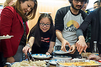 People get Lunar New Year treats from various Asian countries to try at a Lunar New Year celebration at Middlesex Community College's Asian American Connections Center on Thus., Feb. 15, 2018. The Asian American Connections Center was established at the school using a federal grant in 2016 and serves as a focal point for the Asian community at the school, predominantly Cambodian, to gather, socialize, study, and otherwise take part in student life. Bopha Malone, a Trustee of the College, (left in red) joined in the celebration.
