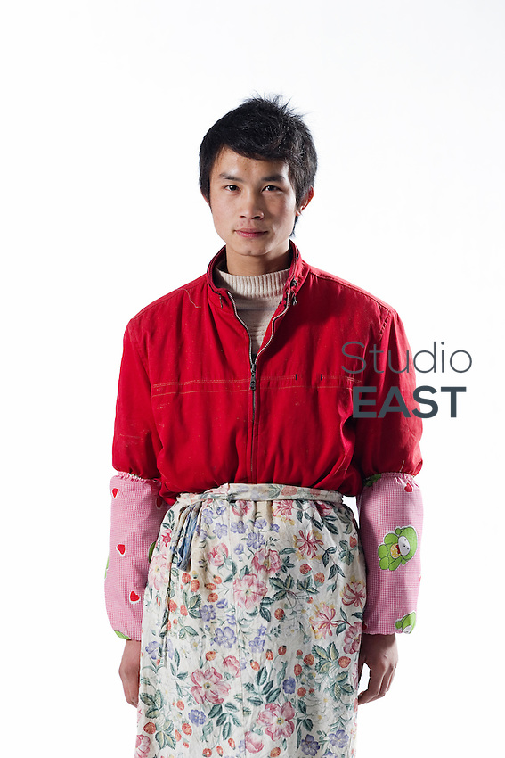 "Worker Wang Song poses for a photograph in Artissmo Designs factory in Yiwu, Zhejiang province, China, on February 14, 2012.  Wang Song, 21-year-old, from Chongqing, is the son of Xu Yuqing and Wang Congming, and works with them in the same factory: ""I am only starting to work. I am happy to be with my parents because we can support one another"". Photo by Lucas Schifres/Pictobank"