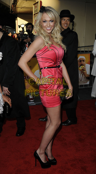 SOPHIE READE.The World Premiere of 'The Infidel' at the Hammersmith Apollo, London, England, UK..April 8th, 2010.arrivals full length dress clutch bag shoes platform smiling waist belt flower hairband hair band black hand on hip side .CAP/CAN.©Can Nguyen/Capital Pictures.