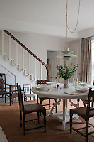 A simple staircase leads from the dining room to the upper floor