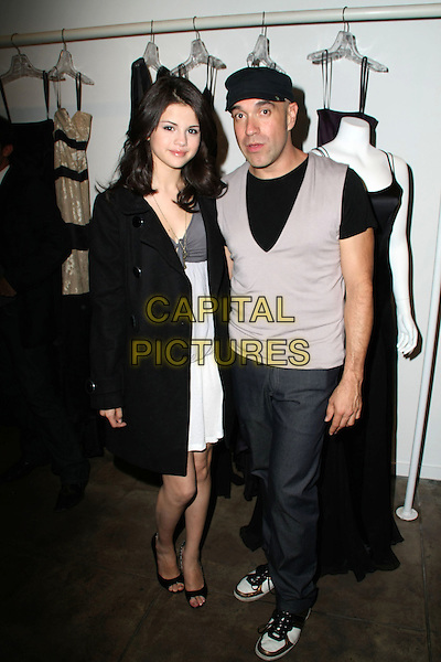 SELENA GOMEZ & OCTAVIO CARLIN.Octavio Carlin Atelier Grand Opening for Carlin Collection Launch held at Carlin Atelier, Los Angeles, California, USA..October 17th, 2008.full length black mac grey gray sleeveless vest trousers hat white dress jacket .CAP/ADM/KB.©Kevan Brooks/AdMedia/Capital Pictures.