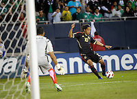 Mexico's Giovani dos Santos shoots on Costa Rica goalkeeper Keylor Navas.  Mexico defeated Costa Rica 4-1 at the 2011 CONCACAF Gold Cup at Soldier Field in Chicago, IL on June 12, 2011.