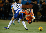 09.02.2019 Kilmarnock v Rangers: Ryan Kent sent flying by Gary Dicker