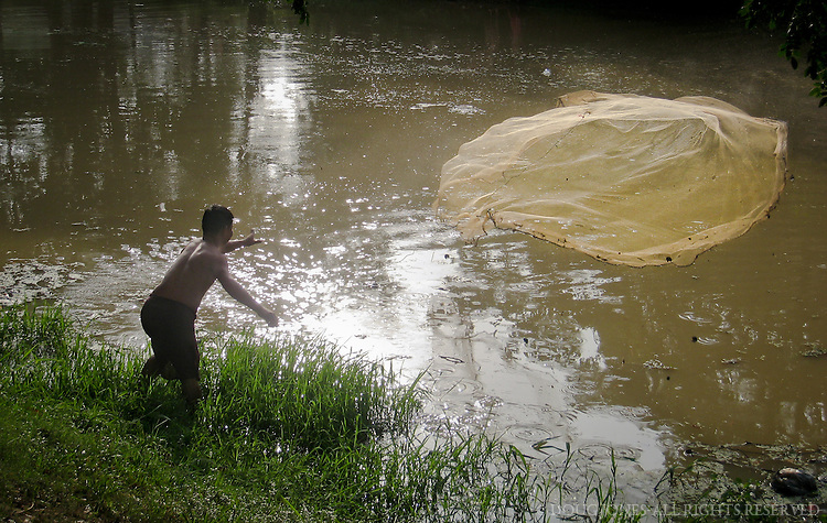 Just after dawn, fisherman like these line the banks of the Siem Reap River that runs through the middle of town.