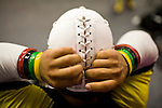 Lucha Libre AAA wrestler Mascarita Sagrada laces up his mask before a match in Sacramento, CA March 28, 2009.