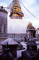 "Swayambhunath, also known as the Monkey Temple. A Buddhdist ""stupa"" (shrine) outside Kathmandu. Buddhist monk walks around in clockwise, traditional fashion. Kathmandu, Nepal Asia."