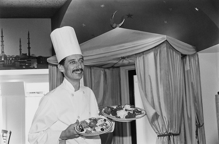 Chef Cavit Durukan holding the Meze appetizer platter and Istanbul kebab. (Photo by Maureen Keating/CQ Roll Call via Getty Images)