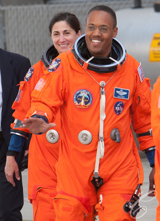 Mission Specialists Alvin Drew, right, and Nicole Stott prepare to board the bus to talke them to Pad 39A for Space Shuttle Discovery's final flight on February 24, 2011.