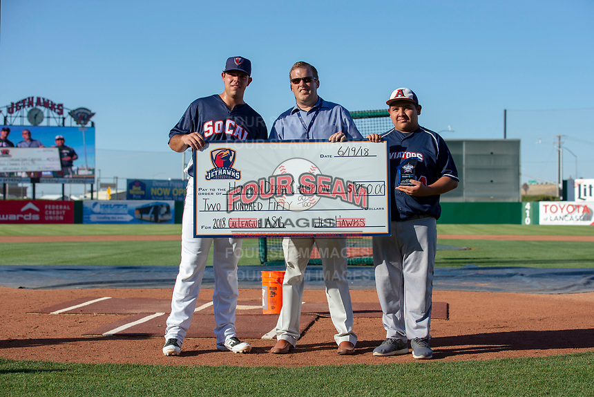 Roberto Ramos (22) of the Lancaster JetHawks receives a check in the amount of $250.00 for winning the Home Run Derby prior to the 2018 California League All-Star Game at The Hangar on June 19, 2018 in Lancaster, California. The North All-Stars defeated the South All-Stars 8-1.  (Donn Parris/Four Seam Images)