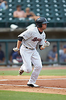 Blake Rutherford (9) of the Birmingham Barons hustles down the first base line against the Pensacola Blue Wahoos at Regions Field on July 7, 2019 in Birmingham, Alabama. The Barons defeated the Blue Wahoos 6-5 in 10 innings. (Brian Westerholt/Four Seam Images)