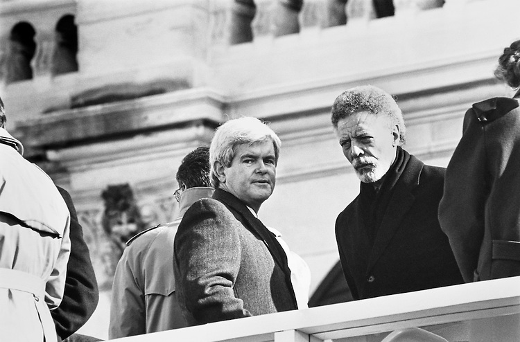 Rep. Newt Gingrich, R-Ga., and Rep. Ron Dellums, D-Calif. at Inauguration Day. January 20, 1993. (Photo by Maureen Keating/CQ Roll Call)